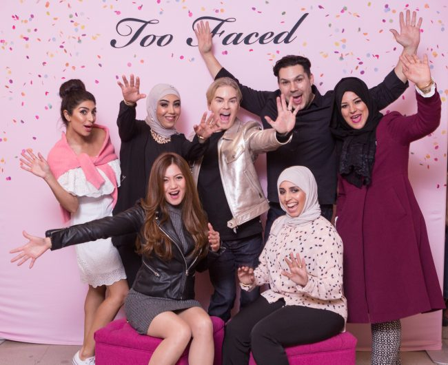 Fun Group in front of step and repeat at Too Faced annual meeting