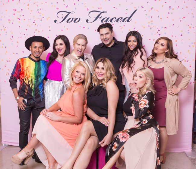 Group in front of step and repeat at Too Faced annual meeting