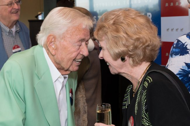 friends greeting at 90th birthday celebration